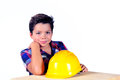 Kid workman young with hard helmet Royalty Free Stock Photo