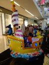 Kiddie ride children were enjoying a at a mall atrium in sukoharjo central java indonesia Royalty Free Stock Photography