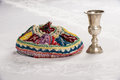 Kiddush cup and colorful yalmulke on linen tablecloth israeli yamulke Royalty Free Stock Images
