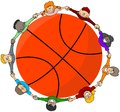 Kids around a basketball Stock Photography