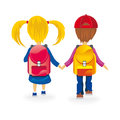Kids back to school go holding hands Stock Photo