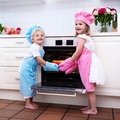 Kids baking apple pie Royalty Free Stock Photo