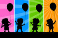 Kids and Balloons Silhouettes Royalty Free Stock Photo