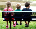 Kids on Bench Royalty Free Stock Photo