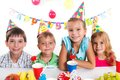 Kids with birthday cake group of adorable having fun at party Stock Image