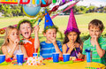 Kids birthday party group of adorable at Royalty Free Stock Image