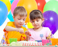 Kids boy and girl eating cake on party birthday Royalty Free Stock Photo