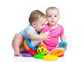 Kids boy girl playing toys together Royalty Free Stock Image