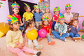 Kids boys and girls sit in circle with toys Royalty Free Stock Photo