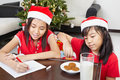 Kids busy preparing letter to Santa Stock Image