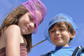 Kids and butterfly nets silly boy girl wear pink blue on their heads Royalty Free Stock Image