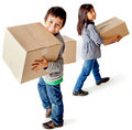 Kids with cardboard boxes Royalty Free Stock Photos