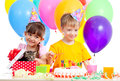 Kids celebrating birthday party and kitten as gift