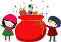 Kids and christmas bag with gifts Royalty Free Stock Photos
