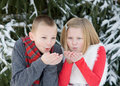 Kids at christmas blowing snow making a wish Stock Image