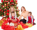 Kids with christmas gift box children near tree isolated Stock Images