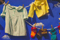 Kids clothes hanging on a washing line Royalty Free Stock Photo