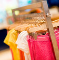 Kids clothes at a store colorful hanging retail on garment racks Stock Photography