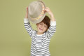 Kids clothing and fashion expressive child with fedora hat children emotional boy a posing having fun Stock Photo