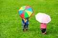 Kids with colorful umbrellas on rainy day Royalty Free Stock Photo