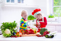 Kids cooking healthy vegetarian lunch