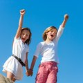 Kids crying out loud with arms raised two shouting and raising hands outdoors Stock Photography