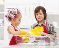 Kids doing the dishes together in kitchen closeup on sink area Royalty Free Stock Photo