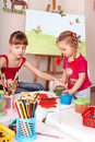 Kids drawing colour pencil in play room. Royalty Free Stock Photo