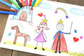 Kids drawing princess and prince Stock Photos