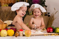 Kids dressed as chefs cooking Stock Photography