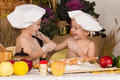 Kids dressed as chefs cooking Stock Photos