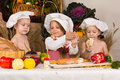 Kids dressed as chefs cooking Stock Photo