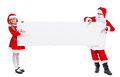 Kids dressed as santa offering you a copy space on banner in costumes white isolated Stock Image