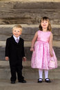 Kids dressed in fancy formal clothes two boy a suit and girl a dress Stock Photography