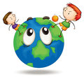 Kids on a earth globe Royalty Free Stock Photo