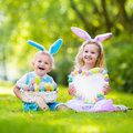 Kids on Easter egg hunt Royalty Free Stock Photo