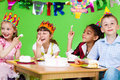Kids eating  cake Stock Image