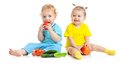 Kids eating fruits and vegetables isolated Royalty Free Stock Photo