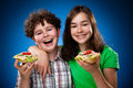 Kids eating healthy sandwiches on green background Royalty Free Stock Photos