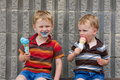 Kids eating ice cream Royalty Free Stock Photo