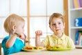Kids eating in kindergarten or at home
