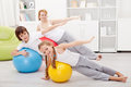 Kids exercising with their mother using large gymnastic balls Stock Images