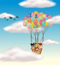 Kids flying in basket Stock Image