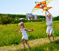 Kids flying kite outdoor. Royalty Free Stock Photography