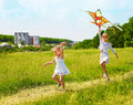 Kids flying kite outdoor. Stock Image