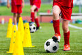 Kids Football Soccer Training.Young Athlete with Football Ball Royalty Free Stock Photo