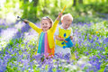 Kids in a garden with bluebell flowers Royalty Free Stock Photo