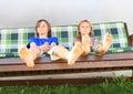 Kids on a garden swing
