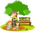 Kids and gardener planting in garden