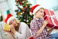 Kids with gifts portrait of happy siblings holding giftboxes and guessing what is inside on christmas evening Stock Image